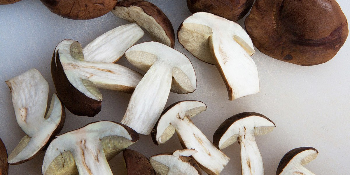 use a knife to cut larger mushrooms into halves, quarters, or slices