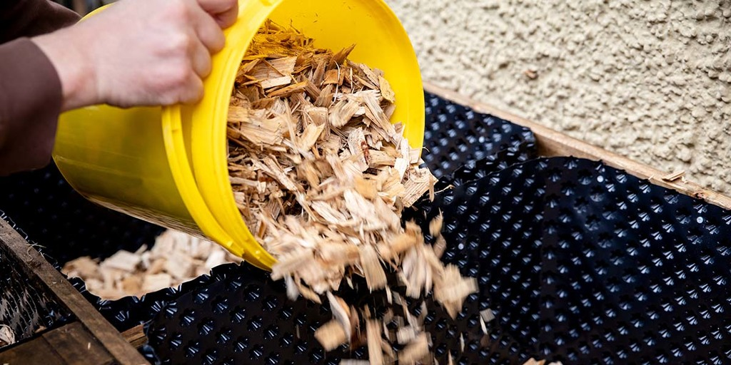Start Layering Your Bed With Wood Chips and Mushroom Spawn