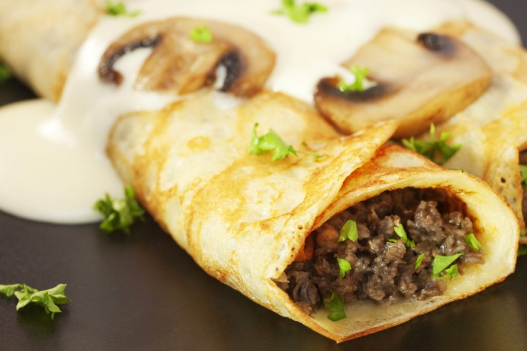 Crepes stuffed with finely chopped mushroom stems.