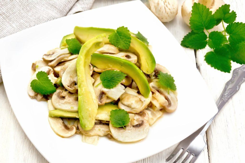 Cleaned, raw mushroom and avocado salad